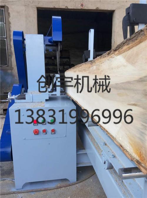 50直径圆木推台锯开板锯厂家气动夹紧木材图片