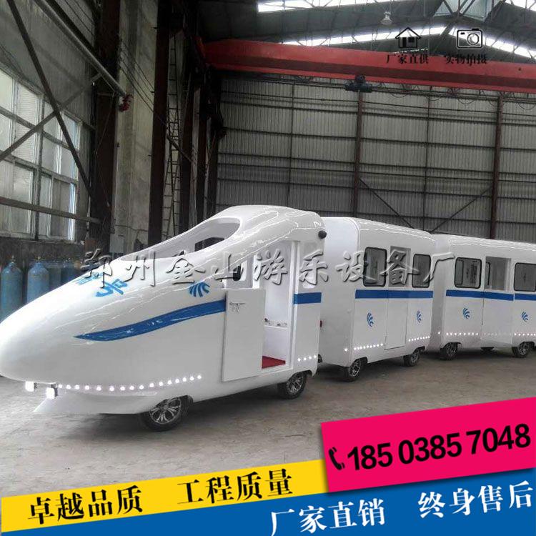 无轨小火车游乐设备是1节车头,4节车厢,可以容纳21人和1个司机可以